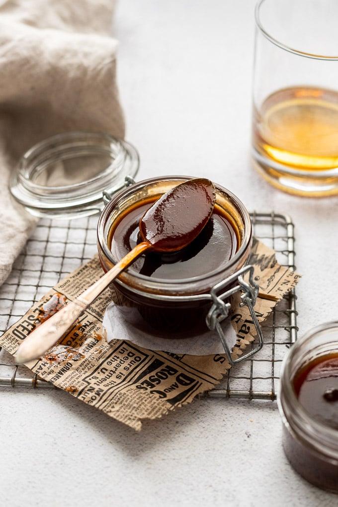 spoon on top of jar of bourbon bbq sauce