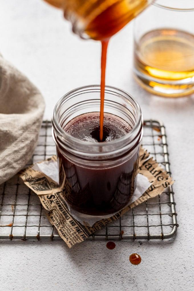 pouring bourbon bbq sauce into jar