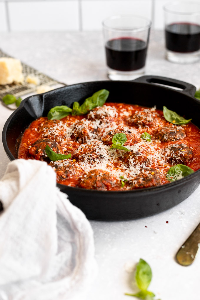 side view of cast iron skillet with vegetarian meatballs