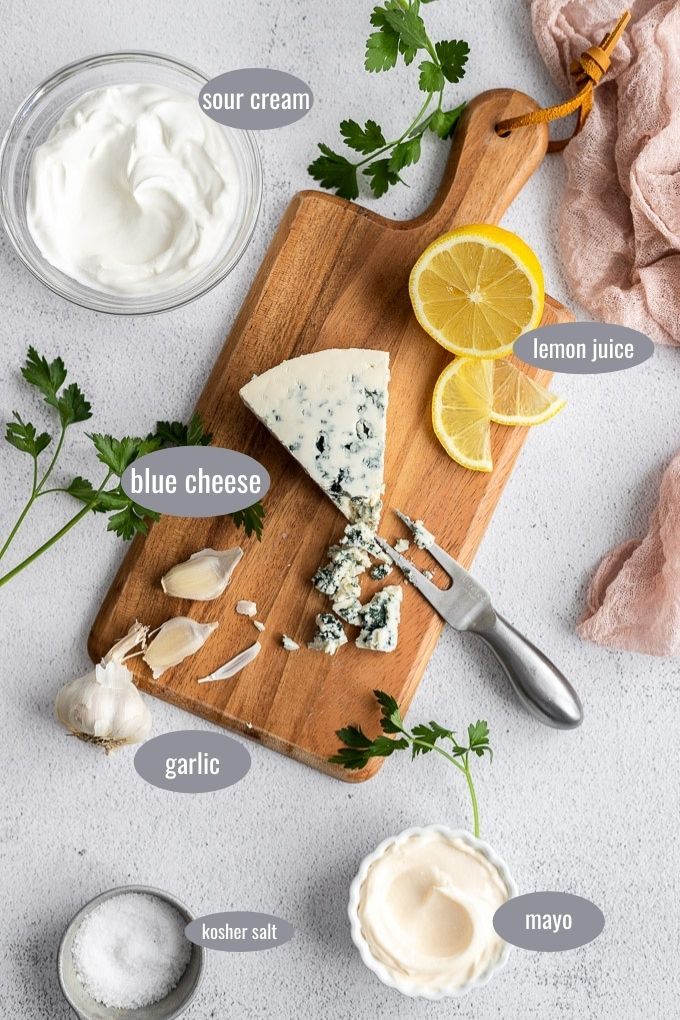 homemade chunky blue cheese ingredients on wood cutting board
