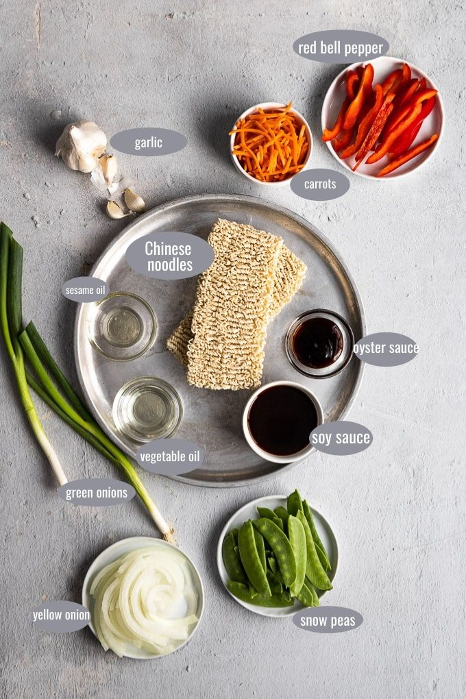 vegetable lo mein ingredients laid out on silver tray