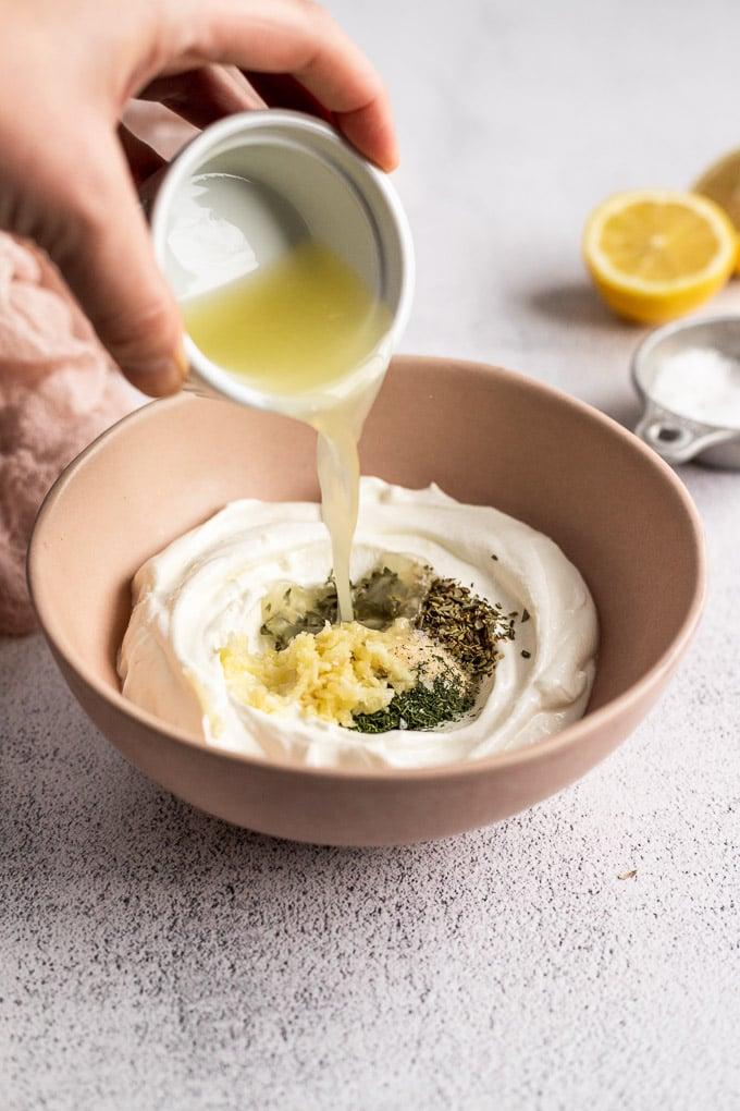 pouring lemon juice into bowl
