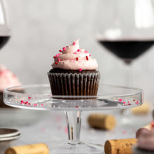 red wine cupcake on cake stand with wine glasses