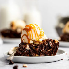 slice of triple chocolate skillet cookie with ice cream and caramel