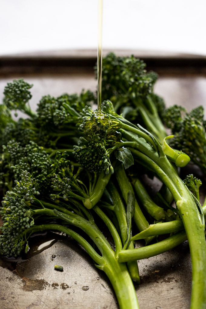 olive oil drizzling on broccolini