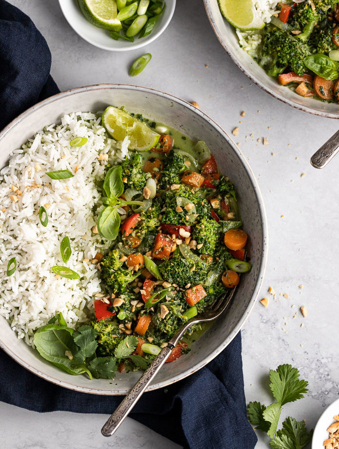 bowl of coconut vegetable stir fry with rice and fork