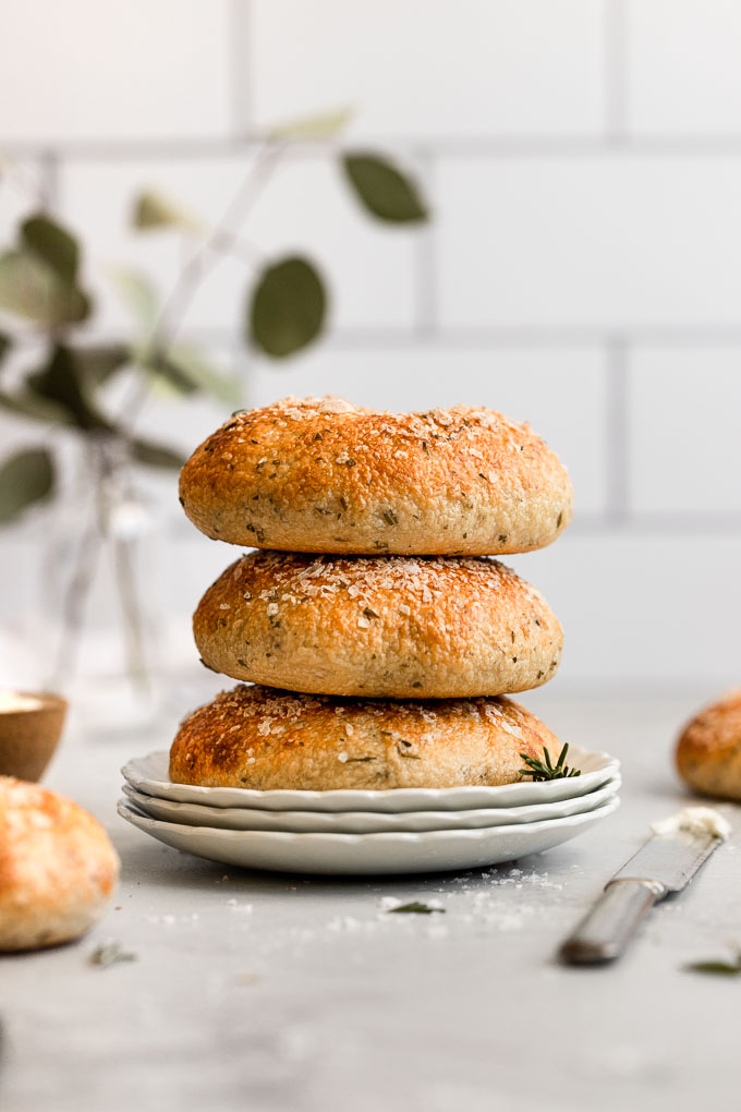 stack of rosemary bagels on plate