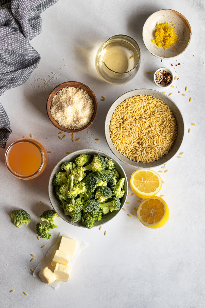 the ingredients for parmesan orzo laid out in bowls