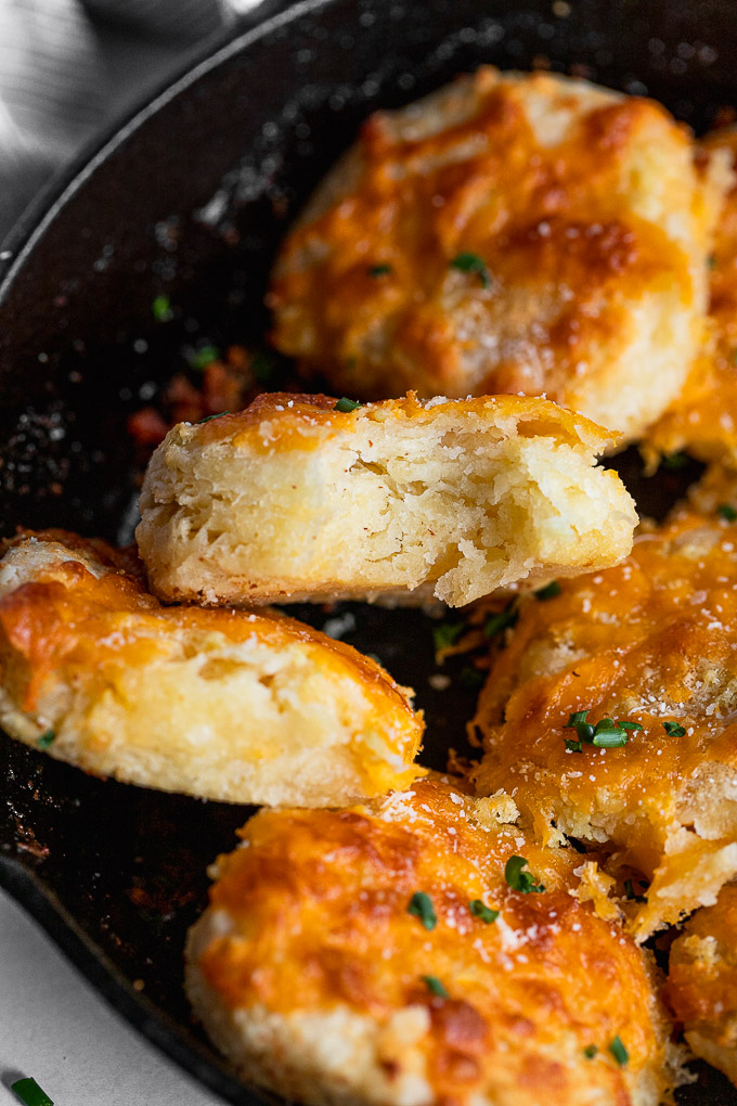 Bite out of biscuit in skillet.