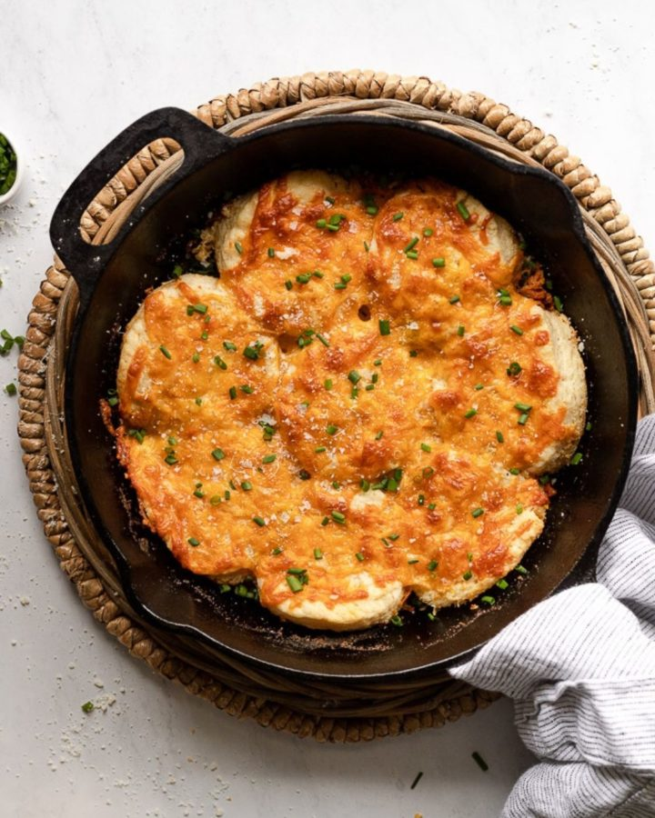 Cast iron skillet with cheesy garlic biscuits.