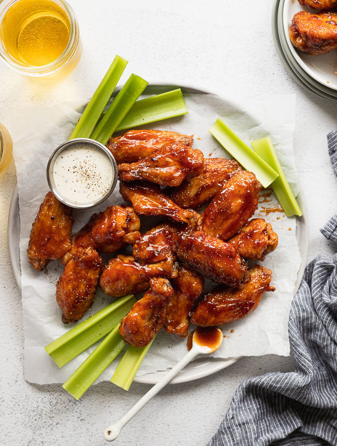 Chicken wings on serving tray with celery.