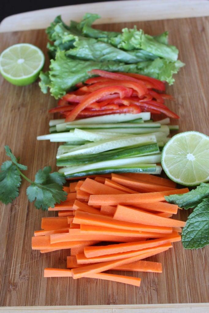 Fresh vegetables sliced on cutting board.