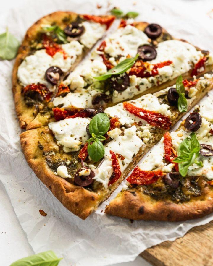 Up close slice of mediterranean pizza.