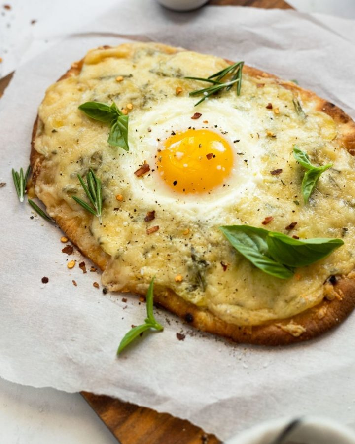 Rosemary potato flatbread with egg and garnishes.