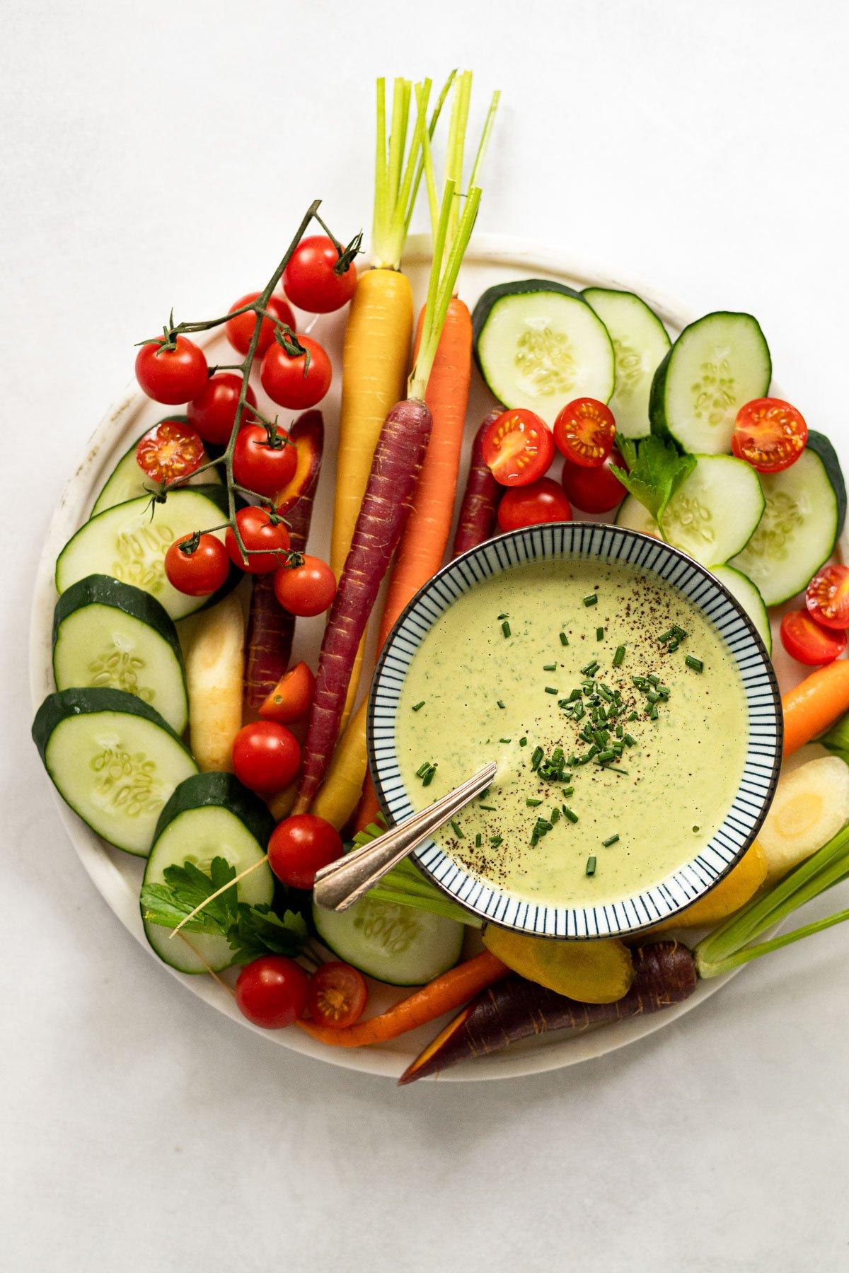 Tahini sauce on vegetable board.