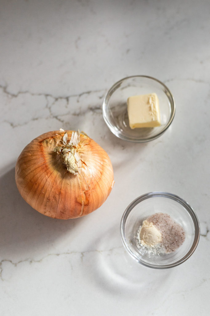 Onion, butter, salt, and powders in bowls.