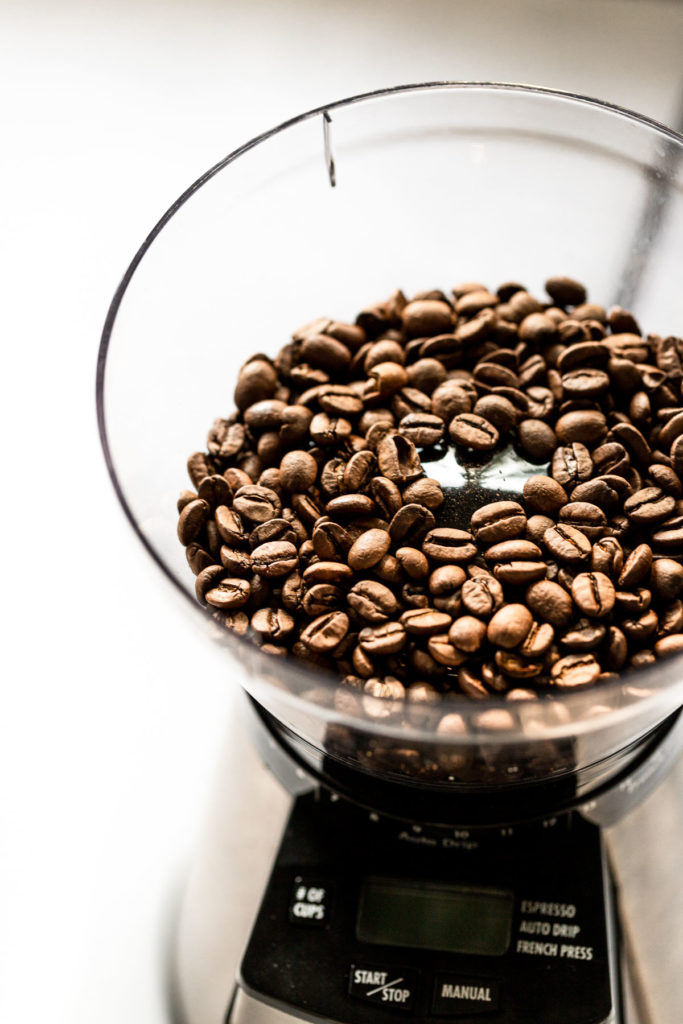 Coffee beans in grinder.