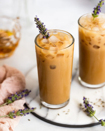 Two lavender honey lattes on white tray.