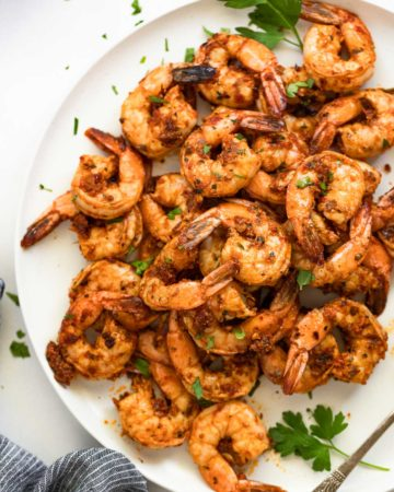 Up close shrimp on white plate.