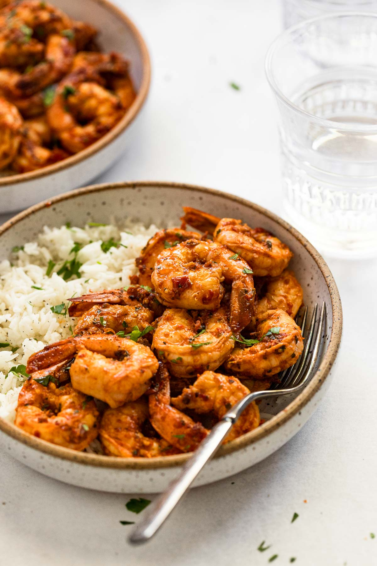 Bowl with rice and shrimp.