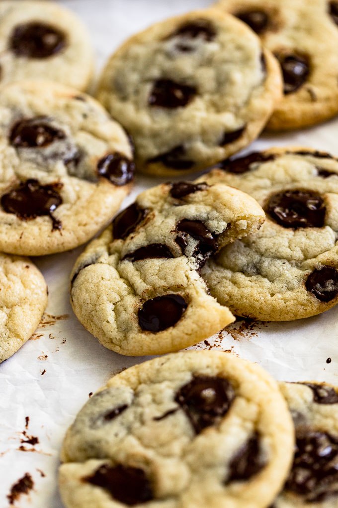 Cookie pile with one bite out.